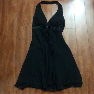A silk black dress. Worn once.